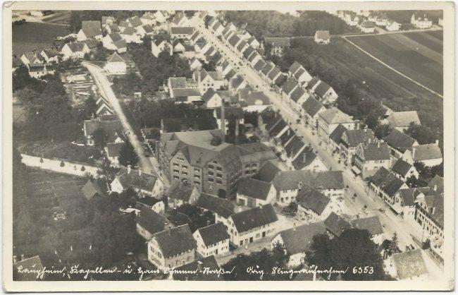 Laupheim, Kapellen- u. Hans Schemm-Straße. Orig. Fliegeraufnahme 6953 (Vorderseite der Ansichtskarte)